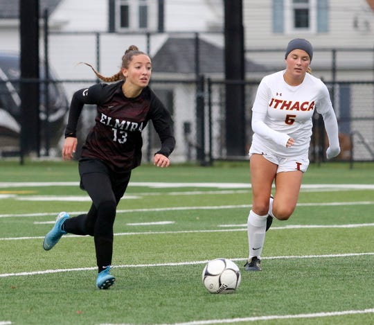 Elmira's Parker Moss (13) brings the ball up the field as Ithaca's Emma Hagen gives chase during the Section 4 class AA girls soccer final Nov. 1, 2019 at Waverly Memorial Stadium.