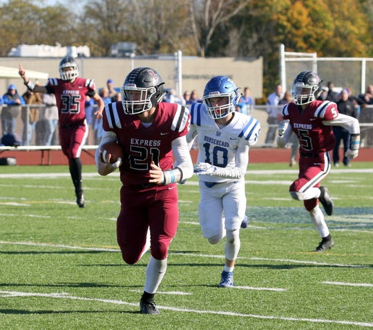 Nate Latshaw of Elmira returns an interception for a touchdown as Ryan Scott of Horseheads gives chase during the Express' 28-12 win in a Section 4 Class AA semifinal Nov. 2, 2019 at Ernie Davis Academy.