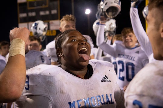 Memorial's De'marko Vaughn (79) celebrates Memorial's win against Boonville after the 4A sectional semifinal at Boonville High School Friday night, Nov. 1, 2019.