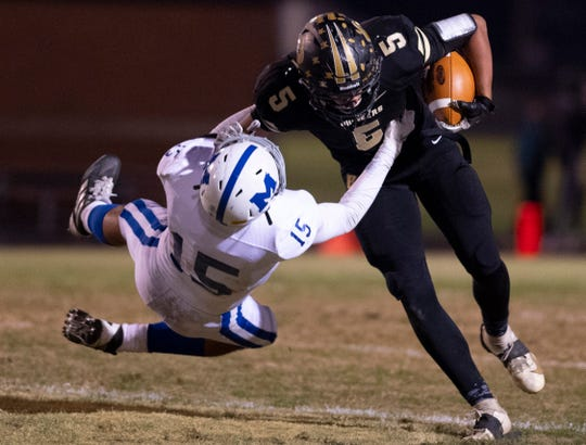Memorial's Evan Quick (15) tries to tackle Boonville's Devin Mockobee (5) during the 4A sectional semifinal at Boonville High School Friday night, Nov. 1, 2019.