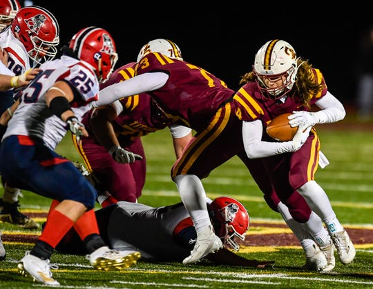 Gibson Southern's Ben Butler (4) rushes through a hole in the defense as the Gibson Southern Titans play the Heritage Hills Patriots in the Class 3A Sectional 32 semifinals in Fort Branch Friday evening, November 1, 2019.