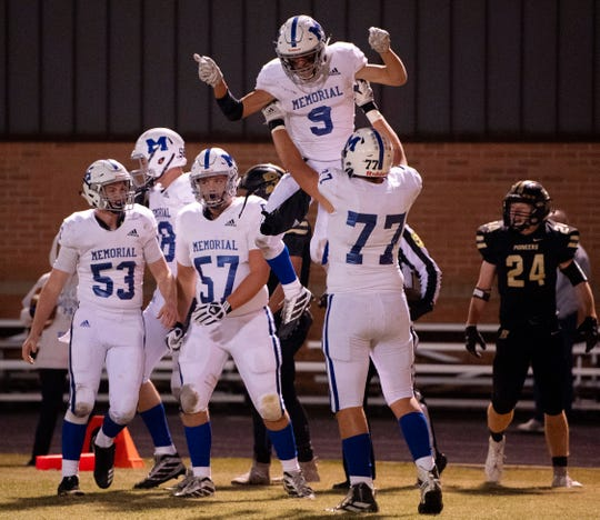 Memorial's Josh Russell (9) is hoisted into the air by Memorial's Zachary Pruitt (77) after a touchdown against Boonville during the 4A sectional semifinal at Boonville High School Friday night, Nov. 1, 2019.