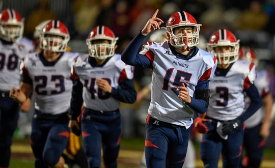 Heritage Hills quarterback Cole Sigler (15) heads to the bench after scoring a fourth quarter touchdown as the Gibson Southern Titans play the Heritage Hills Patriots in the Class 3A Sectional 32 semifinals in Fort Branch Friday evening, November 1, 2019.