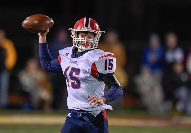 Heritage Hills quarterback Cole Sigler (15) looks for a receiver as the Gibson Southern Titans play the Heritage Hills Patriots in the Class 3A Sectional 32 semifinals in Fort Branch Friday evening, November 1, 2019.