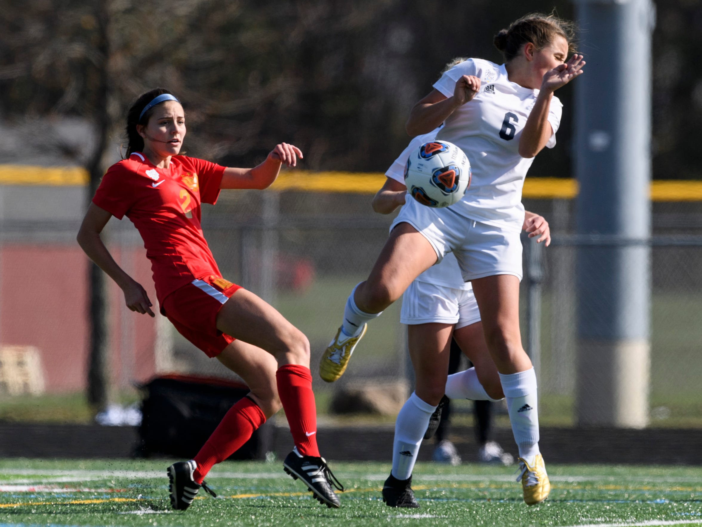 Mater Dei's Este Bonnell (2) kicks the ball around Fort Wayne Bishop Dwenger's Karley O'Leary (6) during the IHSAA Class 2A girls state soccer championship at Fishers High School in Fishers, Ind., Saturday, Nov. 2, 2019. The Wildcats defeated the Saints, 2-0, to win their third consecutive championship title after moving up to 2A this year.