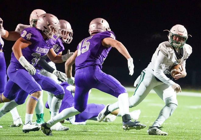 North quarterback Ethan Brawdy scrambles while being pursued by multiple Bloomington South defenders, North at Bloomington South, Nov. 1, 2019.