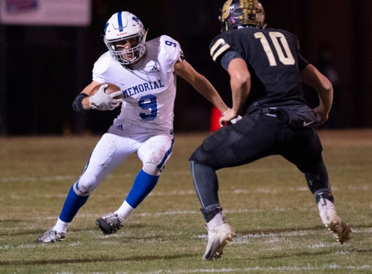 Memorial's Josh Russell (9) runs against Boonville's Jackson Phillips (10) during the 4A sectional semifinal at Boonville High School Friday night, Nov. 1, 2019.