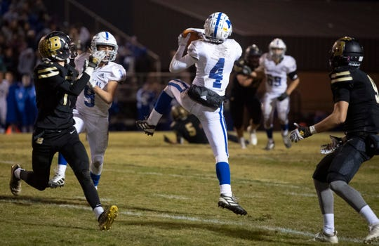 Memorial's Connor Agler (4) intercepts a Boonville pass and runs it in for a touchdown during the 4A sectional semifinal at Boonville High School Friday night, Nov. 1, 2019.