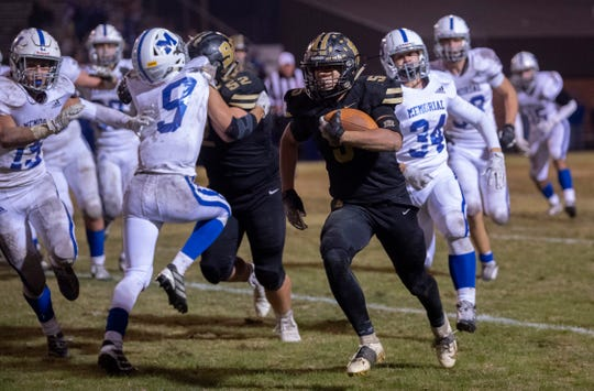 Boonville's Devin Mockobee (5) runs around the Memorial defense on his way to a touchdown during the 4A sectional semifinal at Boonville High School Friday night, Nov. 1, 2019.