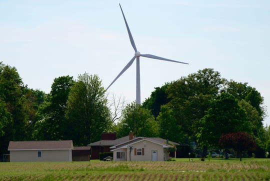 A wind turbine churning in Findlay. An adjudicatory hearing for the Republic Wind Farm project begins Monday, as APEX Clean Energy and residents opposed to the proposed wind energy field make their case to the Ohio Power Siting Board.