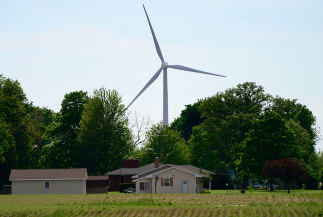 A wind turbine churning in Findlay. An adjudicatory hearing for the Republic Wind Farm project begins Monday, as APEX Clean Energy and residents opposed tothe proposed wind energy field make their case to the Ohio Power Siting Board.