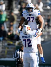 Colorado State Rams offensive lineman T.J. Storment (72) lifts Colorado State Rams running back Jaylen Thomas (27) after Thomas scored a touchdown in the first quarter of the game at Canvas Stadium at Colorado State University in Fort Collins, Colo. on Saturday, Nov. 2, 2019.