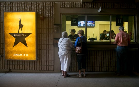 Pamela Sanderson, left, and Bonnie Kerscher get their tickets for Hamilton at Barbara B. Mann Performing Arts Hall in Fort Myers on Saturday, November 2, 2019.