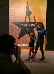 Michelle Hamstra and her daughter Abigail Kuntze, 8, pose in front of the Hamilton poster while waiting to get tickets at Barbara B. Mann Performing Arts Hall in Fort Myers on Saturday, November 2, 2019.