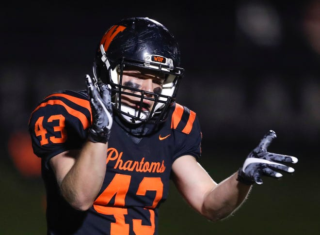 West De Pere's Jourdon Schuyler celebrates a touchdown during the Phantoms' victory over Grafton on Friday.