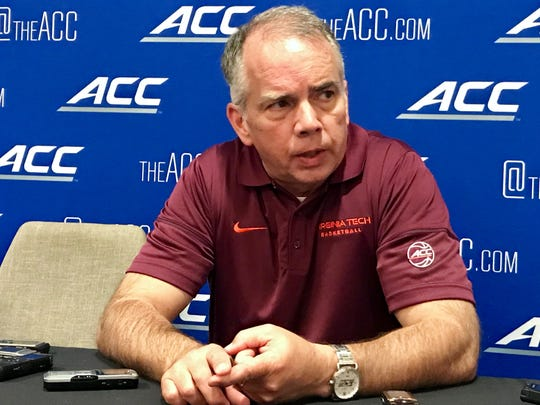 Virginia Tech coach Mike Young addresses the media at the ACC Basketball Tipoff in Charlotte.