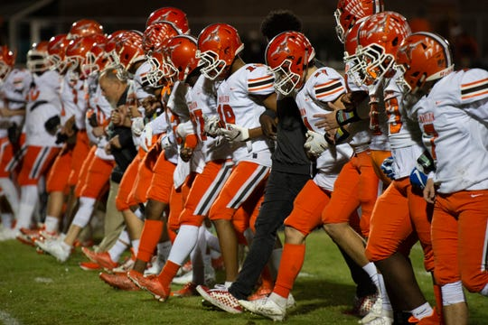 The Mauldin football team walks across the field before the start of the game at Hillcrest Friday, Nov. 1, 2019.