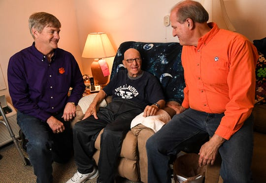 John Biediger, left, Joe Casolaro, middle, and Frank Jacky, right, talk about Casolaro's role in the U.S. Navy during World War II and the life he had after that from his home in Anderson Saturday.