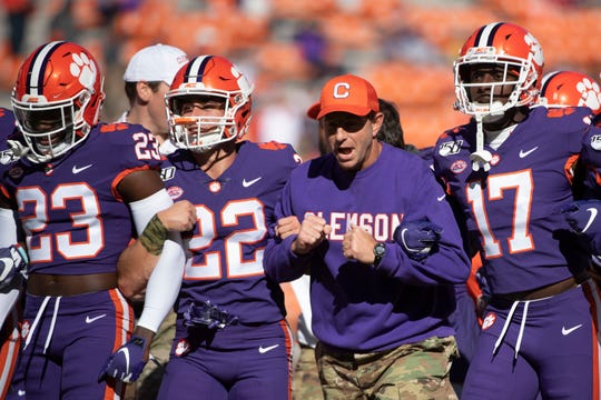 Clemson Head Coach Dabo Swinney and the Clemson football team walk the field before the game against Wofford at Memorial Stadium in Clemson Saturday, November 2, 2019.