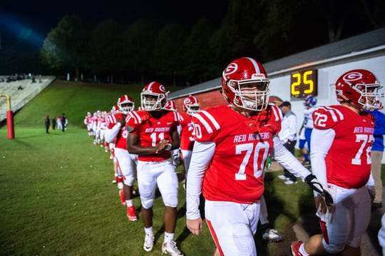 The Greenville High School football team begins their traditional walk around Sirrine Stadium before their game against Eastside Friday, November 1, 2019. Greenville won 24-17.