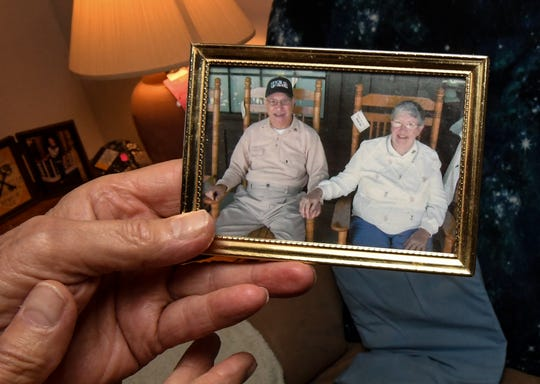 Joe Casolaro of Anderson holds a photo of him and his wife Betty as he talks about his role in the U.S. Navy during World War II and the life he had after that from his home in Anderson Saturday.