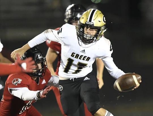 Greer quarterback Hollis Crosby (17) gets around the Blue Ridge defense Friday night at Blue Ridge High School.