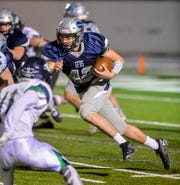 Great Falls High's Ryan Krahe carries the football during Friday's game against Glacier at Memorial Stadium.