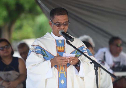 Rev. Danilo Trajano delivers his sermon during an All Souls' Day Mass at Vicente Limtiaco Cemetery, Nimitz Hill, Nov. 2, 2019.