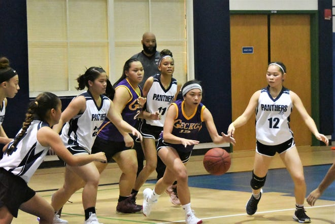GW Geckos Haley Banez, at center, gets control of a rebound and prepares to race downcourt in her game against the Guam High Panthers Nov. 1 at Guam High.