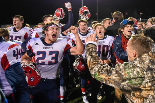 The Heritage Hills Patriots celebrate a 21-20 win over the Gibson Southern Titans in the Class 3A Sectional 32 semifinals in Fort Branch Friday evening, November 1, 2019.