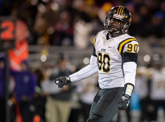 Avon High School senior Nathaniel James (90) reacts to stopping a Brownsburg High School drive during the second half of action in a first-round game of the IHSAA Class 6A varsity football sectional, Friday, Nov. 1, 2019. Brownsburg upset top-ranked Avon 27-24.