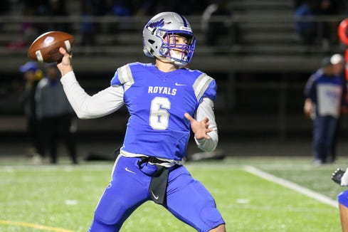 Hamilton Southeastern Andrew Hobson (6) with the pass during the first half of Hamilton Southeastern vs Carmel High School in the first round of 6A IHSAA varsity football sectionals held at Hamilton Sountheastern High School November 1, 2019.