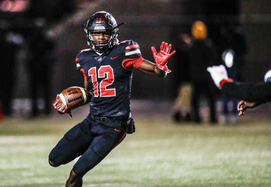 North Central Panthers Richard Hamilton (12), runs the ball, during a IHSAA high school sectional game between Warren Central High School and North Central High School, held at NCHS in Indianapolis on Friday, Nov. 1, 2019.