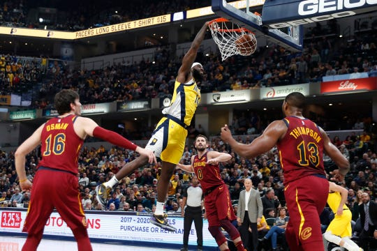 Nov 1, 2019; Indianapolis, IN, USA; Indiana Pacers forward JaKarr Sampson (14) dunks against Cleveland Cavaliers center Tristan Thompson (13) during the first quarter at Bankers Life Fieldhouse. Mandatory Credit: Brian Spurlock-USA TODAY Sports