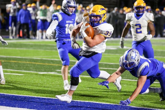 Carmel High School Zach White (39) over the goal line for 6 points during the first half of Hamilton Southeastern vs Carmel High School in the first round of 6A IHSAA varsity football sectionals held at Hamilton Sountheastern High School November 1, 2019.