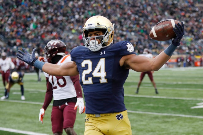 Notre Dame tight end Tommy Tremble (24) runs into the end zone for a after a 4-yard pass reception during the first half of an NCAA college football game against Virginia Tech, Saturday, Nov. 2, 2019, in South Bend, Ind.