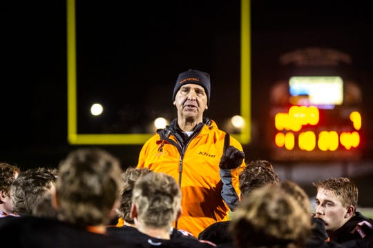 Solon head coach Kevin Miller talks with players after a first round Class 3A varsity football playoff game, Friday, Nov., 1, 2019, at Spartan Stadium in Solon, Iowa.