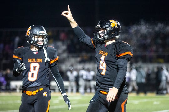 Solon's Camden Miller (4) celebrates with Cole Arduser (8) during a first round Class 3A varsity football playoff game, Friday, Nov., 1, 2019, at Spartan Stadium in Solon, Iowa.