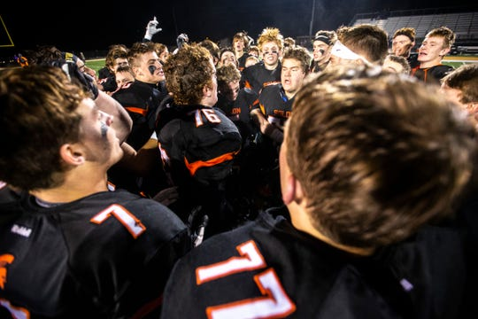 Solon players celebrate after a first round Class 3A varsity football playoff game, Friday, Nov., 1, 2019, at Spartan Stadium in Solon, Iowa. The Spartans defeated Iowa City Liberty, 14-7.