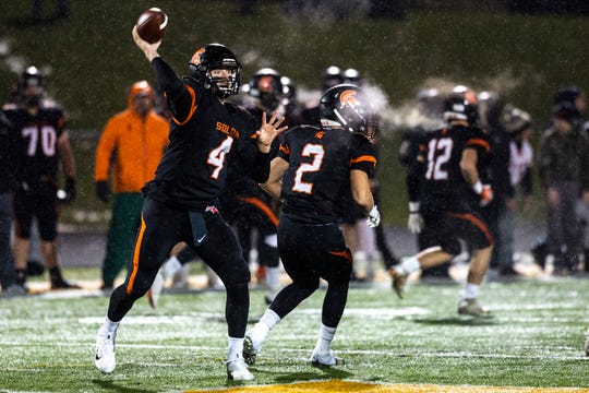 Solon's Camden Miller (4) delivers a pass during a first round Class 3A varsity football playoff game, Friday, Nov., 1, 2019, at Spartan Stadium in Solon, Iowa.