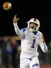 Madison Central's Jimmy Holiday (1) throws against Germantown on Friday, November 1, 2019, at Germantown High School in Gluckstadt, Miss.