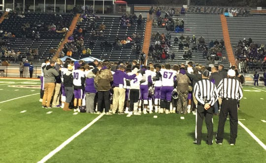 Players from Westview and Milan surround Westview's Cai Ingram and pray after Ingram was injured in the fourth quarter of the Week 11 game.