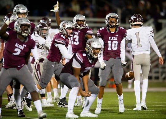 The Tornadoes celebrate after recovering Dobyns-Bennett's fumble during the Alcoa and Dobyns-Bennett football game on Friday, November 1, 2019 at Alcoa High School.