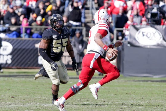 Purdue defensive end Derrick Barnes (55) chases down Nebraska quarterback Adrian Martinez (2) during the third quarter of a NCAA football game, Saturday, Nov. 2, 2019 at Ross-Ade Stadium in West Lafayette.