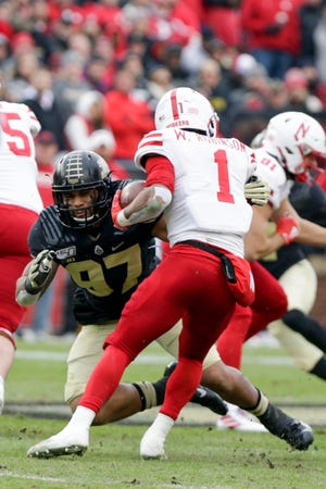 Purdue defensive end Semisi Fakasiieiki (97) tackles Nebraska wide receiver Wan'Dale Robinson (1) during the first quarter of an NCAA football game, Saturday, Nov. 2, 2019 at Ross-Ade Stadium in West Lafayette.
