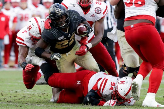Purdue running back King Doerue (22) is taken down during the fourth quarter of a NCAA football game, Saturday, Nov. 2, 2019 at Ross-Ade Stadium in West Lafayette.