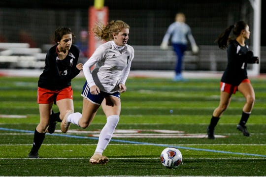 Central Catholic midfielder Karsyn Cherry (1) dribbles down the field during the second half of the IHSAA class A girls soccer state championship, Friday, Nov. 1, 2019, in Fishers.