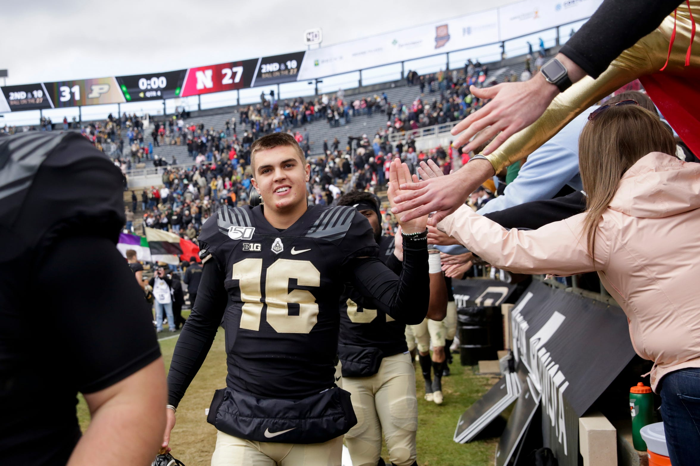 Purdue quarterback Aidan O'Connell (16) celebrates with fans after defeating Nebraska, 31-27, Saturday, Nov. 2, 2019 at Ross-Ade Stadium in West Lafayette.