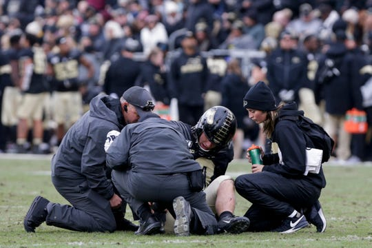 Athletic trainers check on Purdue quarterback Jack Plummer (13) during the fourth quarter of a NCAA football game, Saturday, Nov. 2, 2019 at Ross-Ade Stadium in West Lafayette.