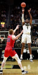 Purdue guard Aaron Wheeler (1) shoots over Southern Indiana forward Justin Carpenter during an exhibition NCAA college basketball game Friday, Nov. 1, 2019, in West Lafayette, Ind. Purdue won 88-59. (AP Photo/R Brent Smith)
